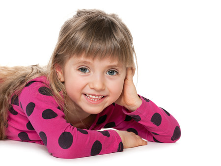 imagines: A cheerful little girl imagines on the white background