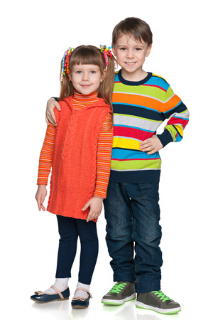 A portrait of two smiling fashion kids against the white background photo