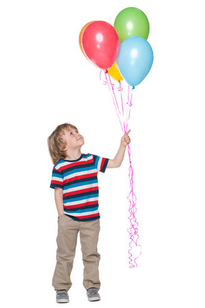 A smiling little boy holds balloons on the white background photo