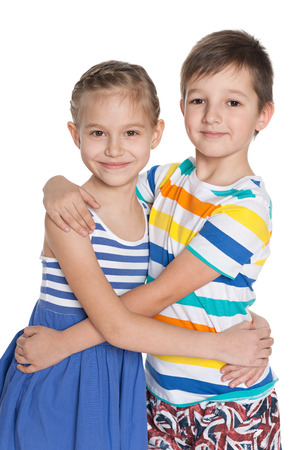 kids hugging: Portrait of two hugging children on the white background Stock Photo