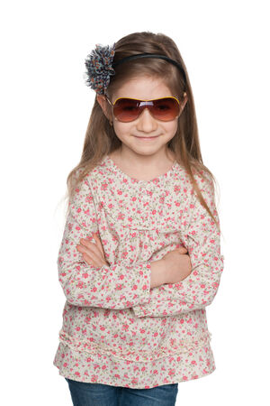 A portrait of a fashion lovely little girl on the white background photo