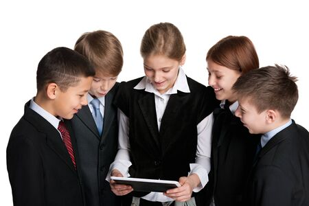 A group of five smiling students with a tablet on the white background photo