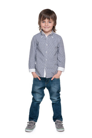 A portrait of a smiling fashion little boy against the white background