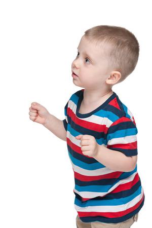 przewidywanie: Mały chłopiec w oczekiwaniu na białym tle Zdjęcie Seryjne