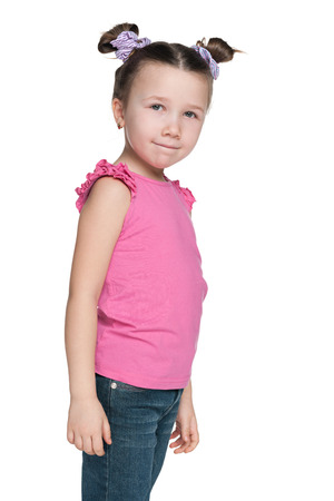 side profile: A portrait of a pretty little girl against the white background