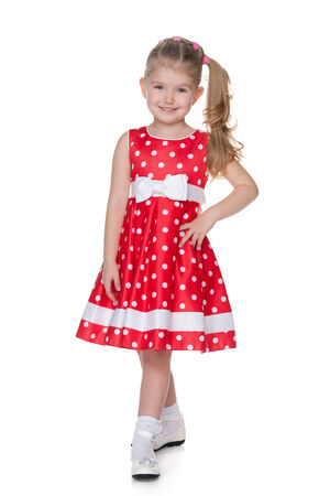 polka dot dress: A pretty little girl in the polka dot dress is standing on the white background