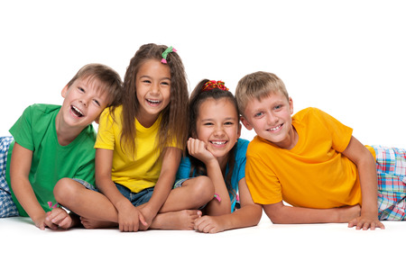 Four laughing children are lying on the white background Stock Photo