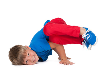 hip hop dancing: A handsome young boy is dancing on the white background Stock Photo