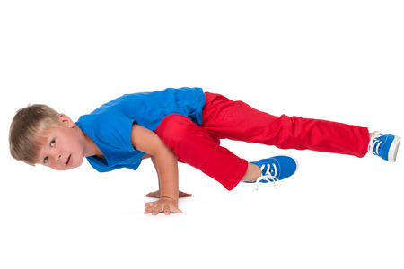 hip hop dancing: A cute little boy is dancing on the white background Stock Photo