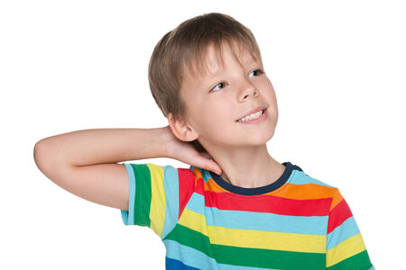 imagines: A little boy in striped shirt imagines against the white background Stock Photo