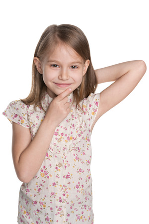 A portrait of a curious young girl on the white background photo