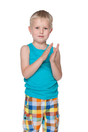 A little boy applauds against the white background photo