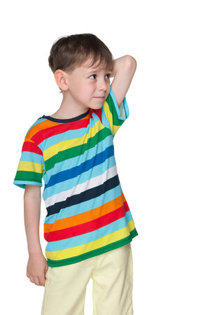 befuddled: A pensive child in a striped shirt is standing against the white background