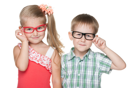 Two clever little kids on the white background photo