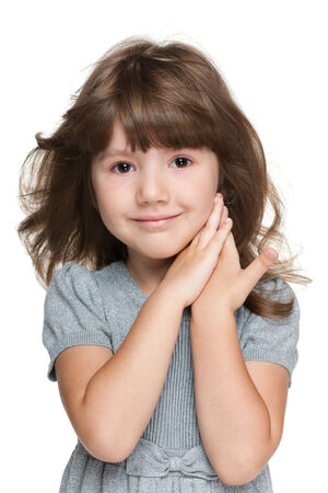 hair studio: A closeup portrait of a shy little girl on the white background