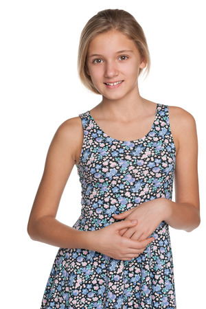 teenager thinking: A portrait of a smiling preteen girl against the white background Stock Photo