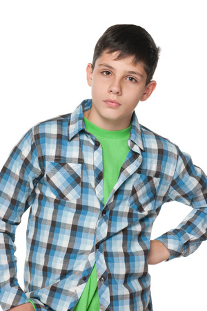 A portrait of an upset teen boy on the white background photo