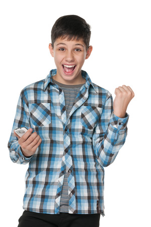 A portrait of a successful boy with a cell phone on the white background photo