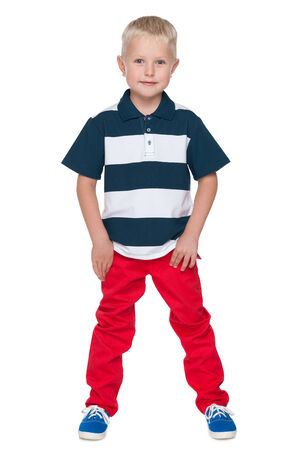 red pants: A portrait of a little boy in the red pants on the white background
