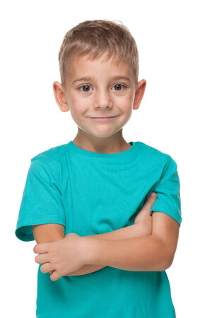 studio portrait: A portrait of a smiling little boy in a blue shirt on the white background Stock Photo