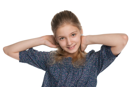 european: A blonde preteen girl on the white background