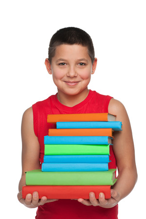 alone boy: A happy preteen boy holds books against the white