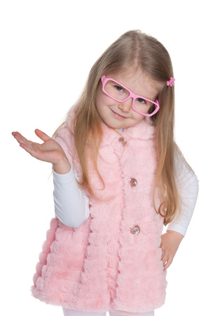 hands out: A portrait of a fashion little girl on the white  Stock Photo
