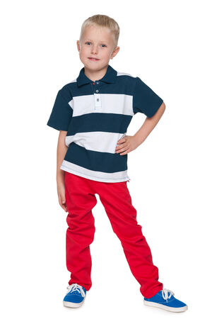 red pants: A portrait of a fashion little boy in the red pants on the white  Stock Photo