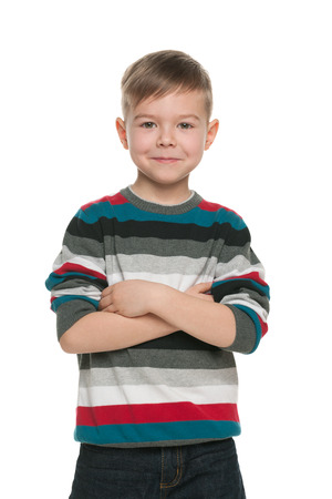 A handsome young boy stands on the white  Stock Photo