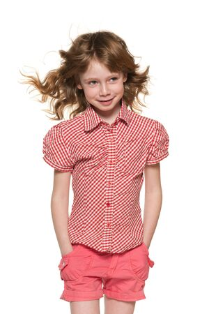 flowing hair: A portrait of a cheerful little girl with flowing hair on the white background