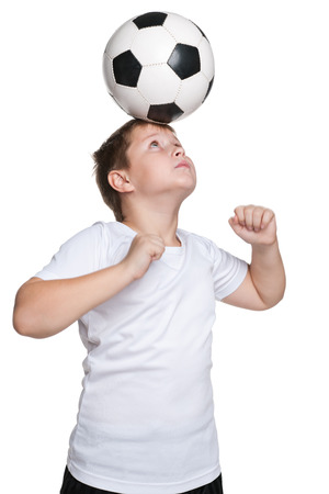 boy ball: A portrait of dexterous footballer with a ball on the white  Stock Photo