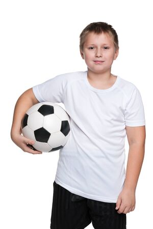 boy ball: A portrait of a confident young boy with soccer ball against the white