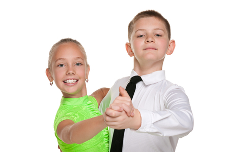 little girl dress: A handsome boy and a pretty girl are dancing against the white background Stock Photo