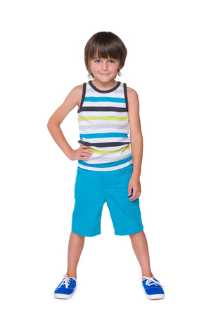 striped vest: A young smiling boy in a striped vest on the white background