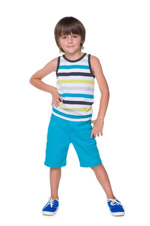 striped vest: A portrait of a cute little boy in a striped vest against the white background Stock Photo