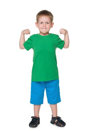 boy muscles: A cute little boy shows results of morning exercises Stock Photo