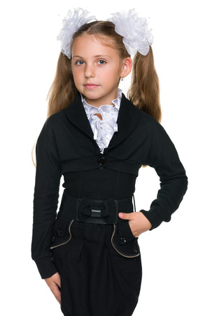 A portrait of a pretty schoolgirl against the white background Stock Photo