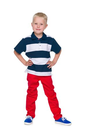 red pants: A portrait of a handsome little boy in the red pants on the white background Stock Photo