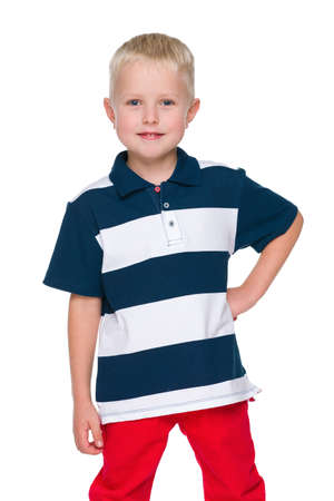 red pants: Happy little boy in the red pants on the white background
