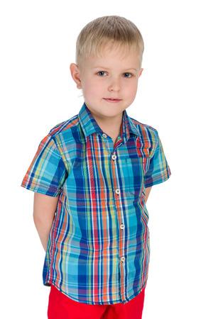 blond boy: A little blond boy stands on the white background