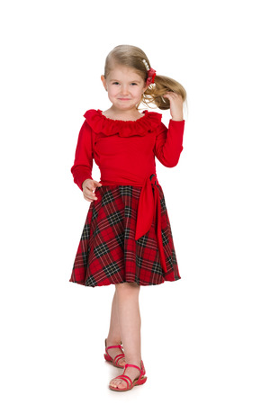 little girl dress: A portrait of a cool little girl in the red dress on the white background