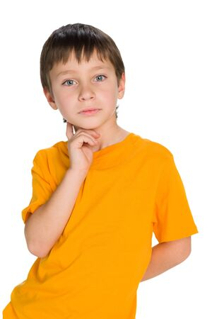 imagines: A handsome young boy imagines on the white background