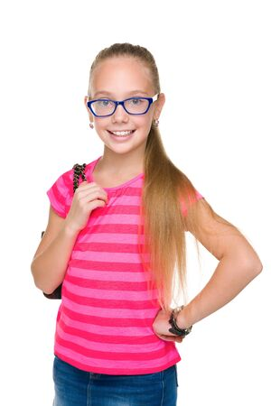 young girl smiling: A smiling fashion young girl in glasses is standing on the white background