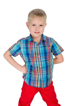 red pants: A handsome little boy in the red pants on the white background