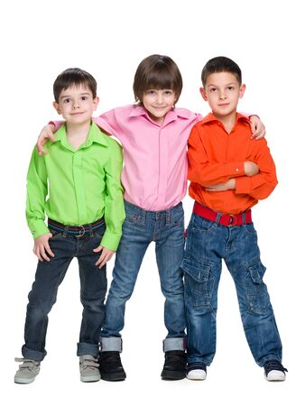 young boys: Three fashion young boys are standing together against the white background