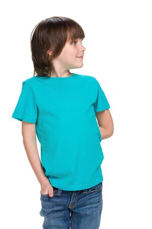 imagines: A cute little boy in a blue shirt imagines on the white background