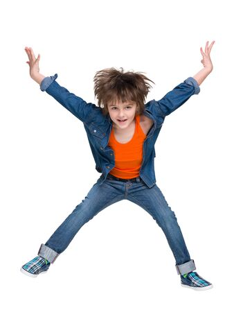 fashion boy: A fashion little boy jumps on the white background Stock Photo