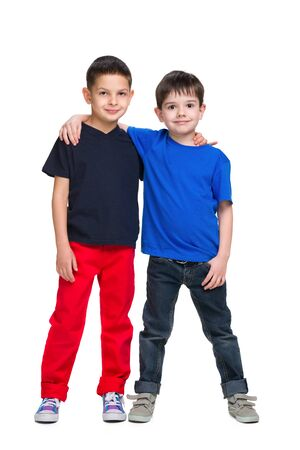 young boys: Two happy young boys stand together against the white background