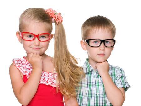A portrait of two clever little children on the white background