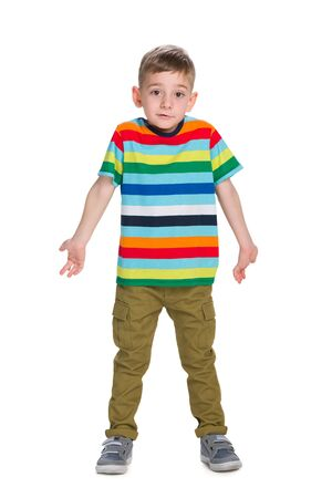 bewildered: A bewildered boy stands on the white background Stock Photo